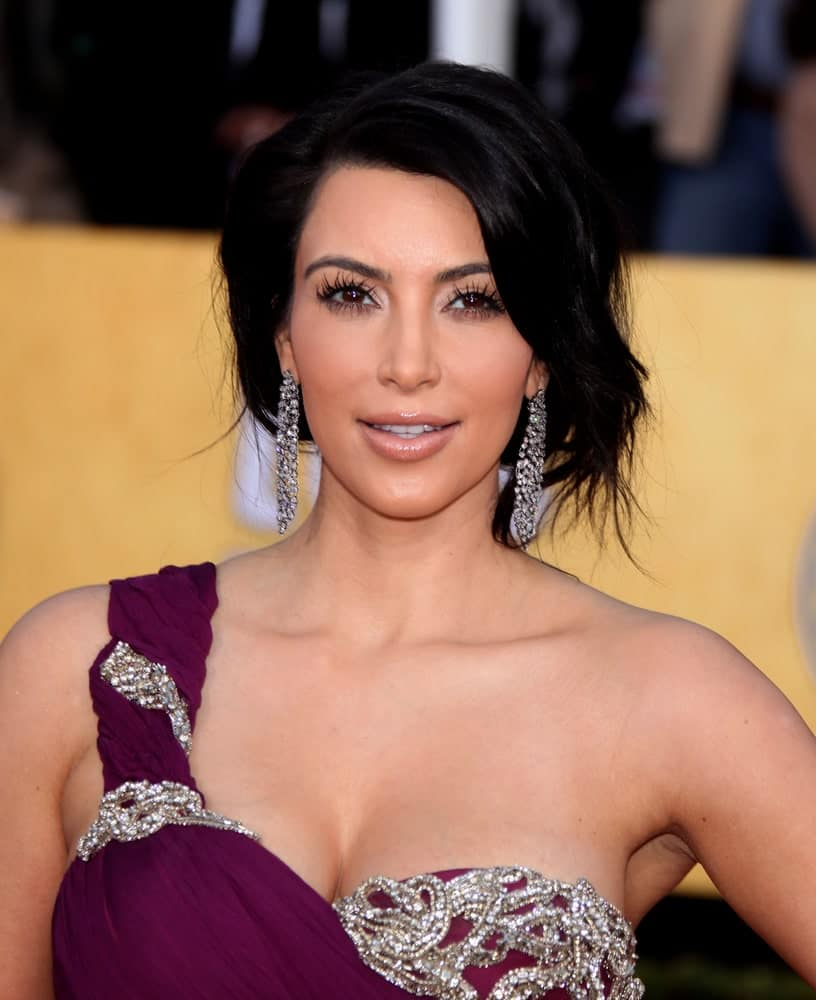 Kim Kardashian pulled off a messy loose upstyle during the 17th Annual Screen Actors Guild Awards at the Shrine Auditorium on January 30, 2011.
