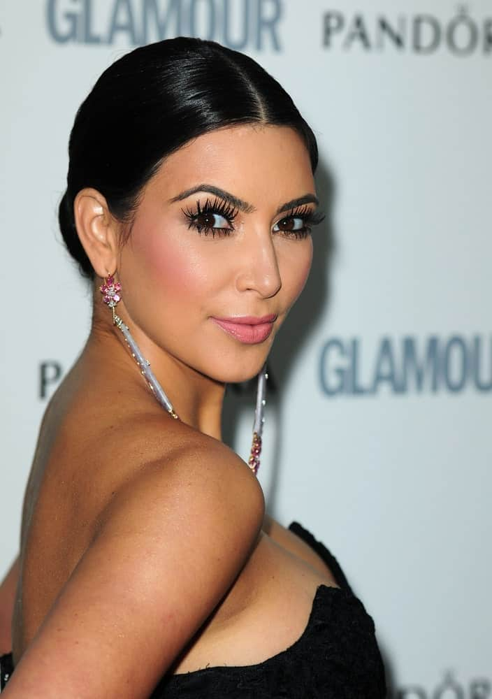 Kim Kardashian looked classy in a neat updo that's paired with gorgeous dangling earrings and a black dress at the 2011 Glamour Awards on July 6, 2011, in Berkeley Square, London.