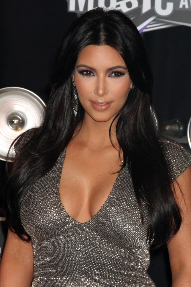 Kim Kardashian styled her long layered black tresses with simple waves and a middle parting during the 2011 MTV Video Music Awards at the LA Live on August 28, 2011.