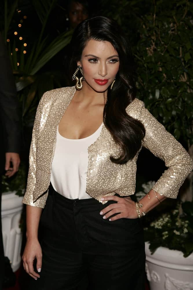 Kim Kardashian exhibited a Hollywood glam aura with her long vintage waves at the QVC Red Carpet Style Party at the Four Seasons Hotel in Beverly Hills on February 25, 2011.