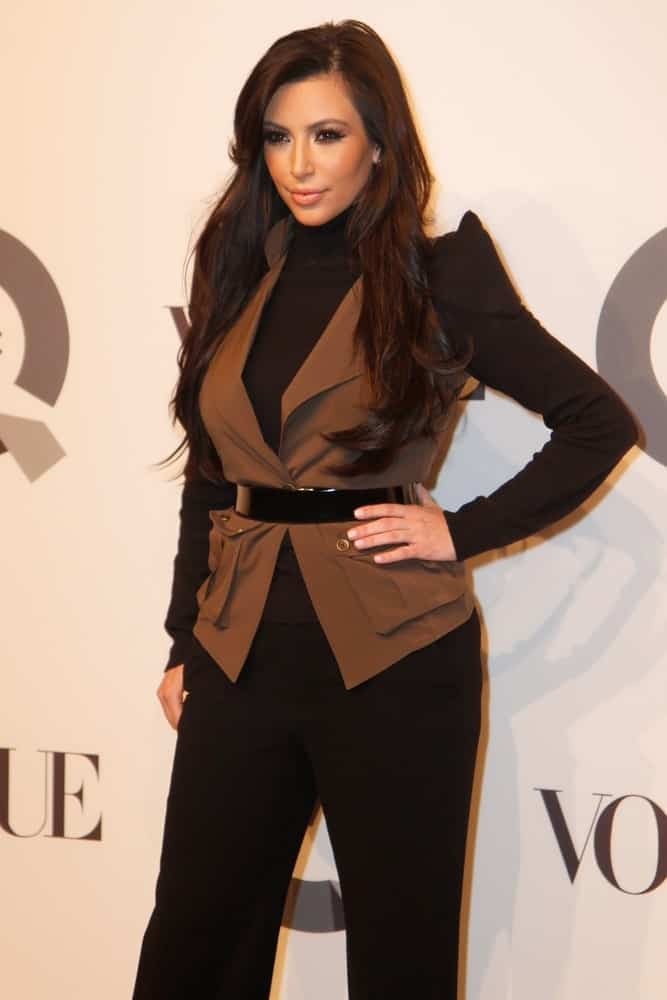 On February 11, 2011, Kim Kardashian attended the QVC 25 to watch party at 229 West 43rd Street sporting her long layered locks with a side part.