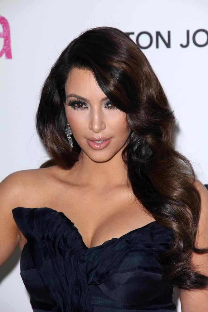 Kim Kardashian in a classic black dress paired with her long brunette waves at the 19th Annual Elton John Aids Foundation Academy Awards Viewing Party held on February 27, 2011.