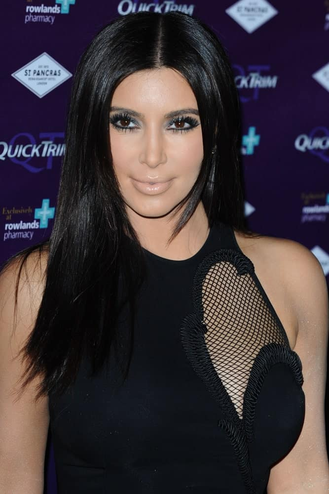 On May 18, 2012, Kim Kardashian attended the Quick Trim launch event at the Renaissance St.Pancras, London showing off her shiny black straight locks with middle parting.