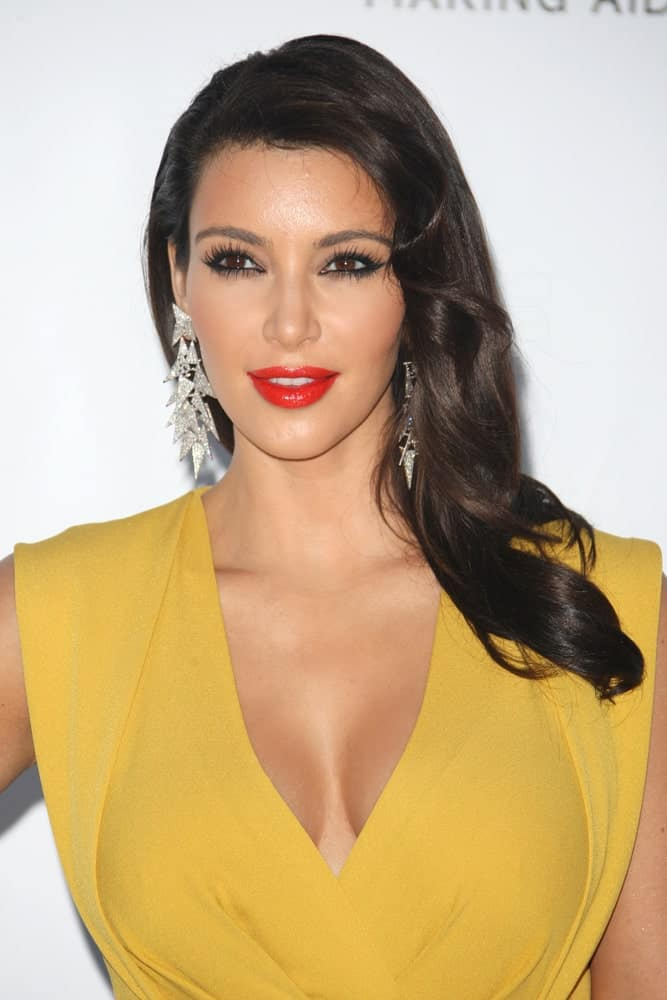 Kim Kardashian flaunted her black side-part waves at the AmfAR's Cinema Against Aids gala 2012 during the 65th annual Cannes Film Festival Cannes, France on May 24, 2012.