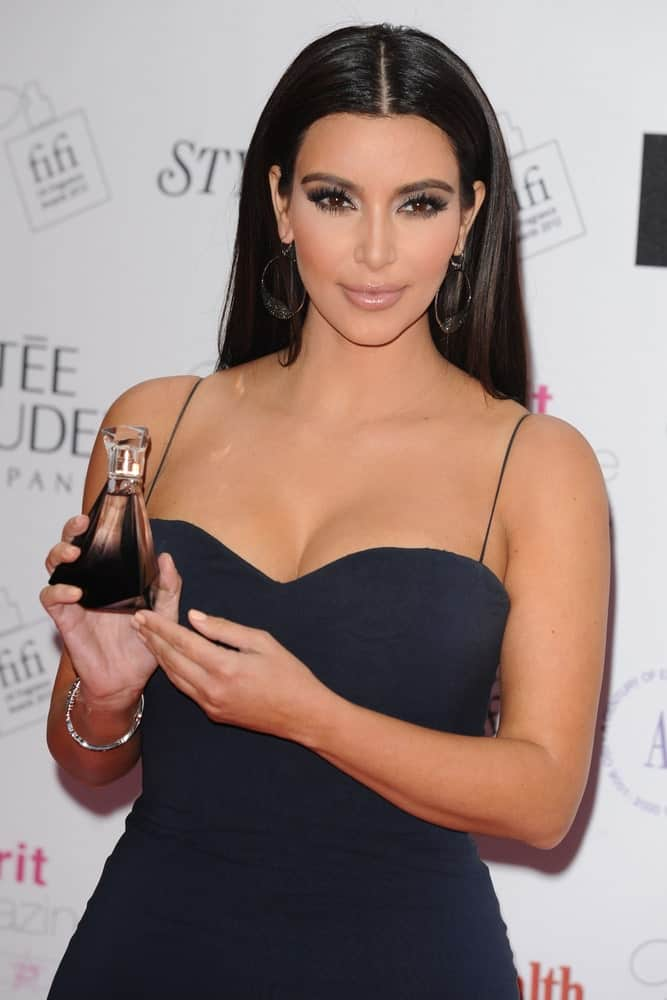 Kim Kardashian arrived for the Fifi fragrance Awards 2012 at the Brewery, London on May 17, 2012, sporting her usual center-parted hair that's tucked behind her ears.
