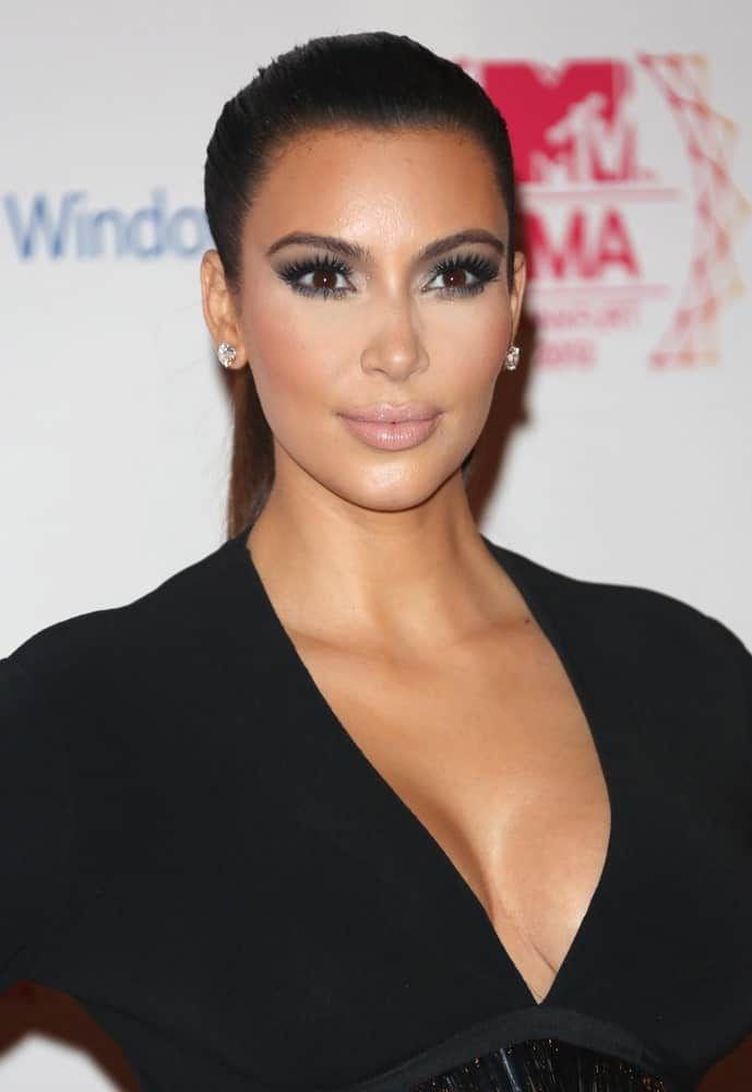 Kim Kardashian slicked back her hair into a high ponytail at The MTV EMA's 2012 held at Festhalle, Frankfurt, Germany on November 11, 2012.