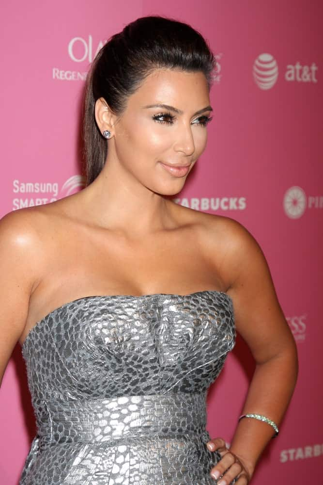 Kim Kardashian with her dark locks arranged into a high ponytail with a pouf at the 2012 US Hot Hollywood Party at Greystone Manor on April 18, 2012.