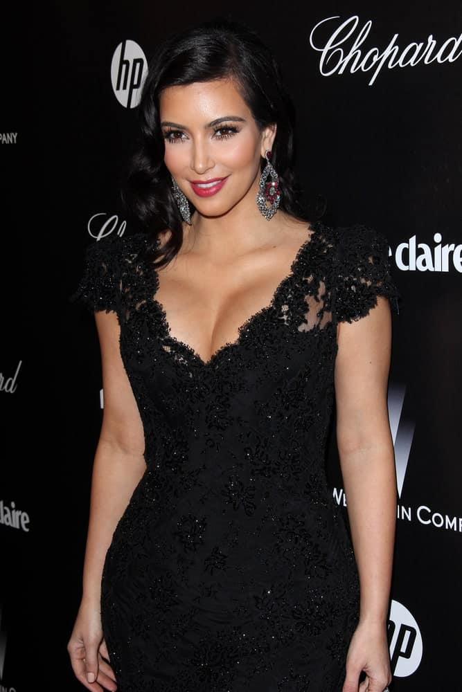 Kim Kardashian looked sophisticated in a black lace gown that perfectly matched her side-parted curls. This look was worn at the Golden Globes 2012 After Party: WB / In Style on January 15, 2012.