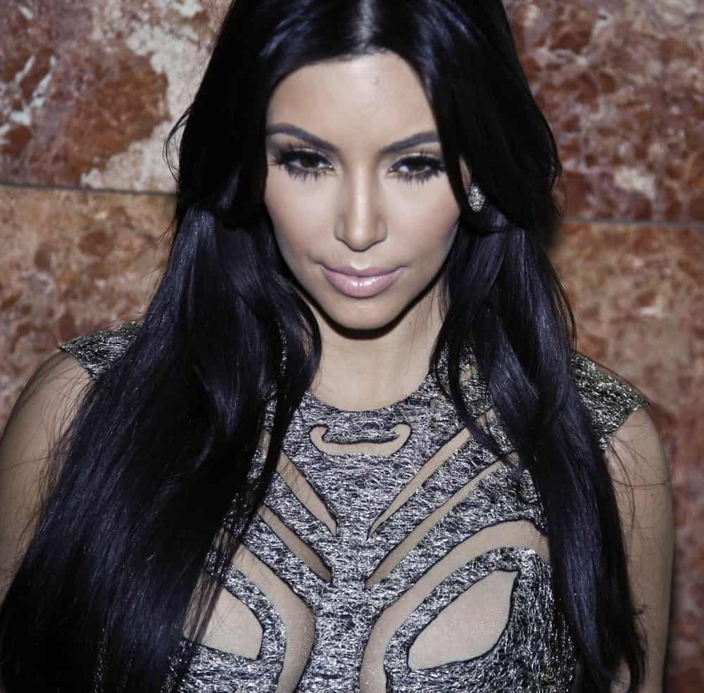 Kim Kardashian made an appearance at the runway show by Sherri Hill at Mercedes-Benz Spring/Summer 2012 Fashion Week in Trump Tower on September 14, 2011. She rocked a sexy outfit that's paired with her center-parted loose waves.