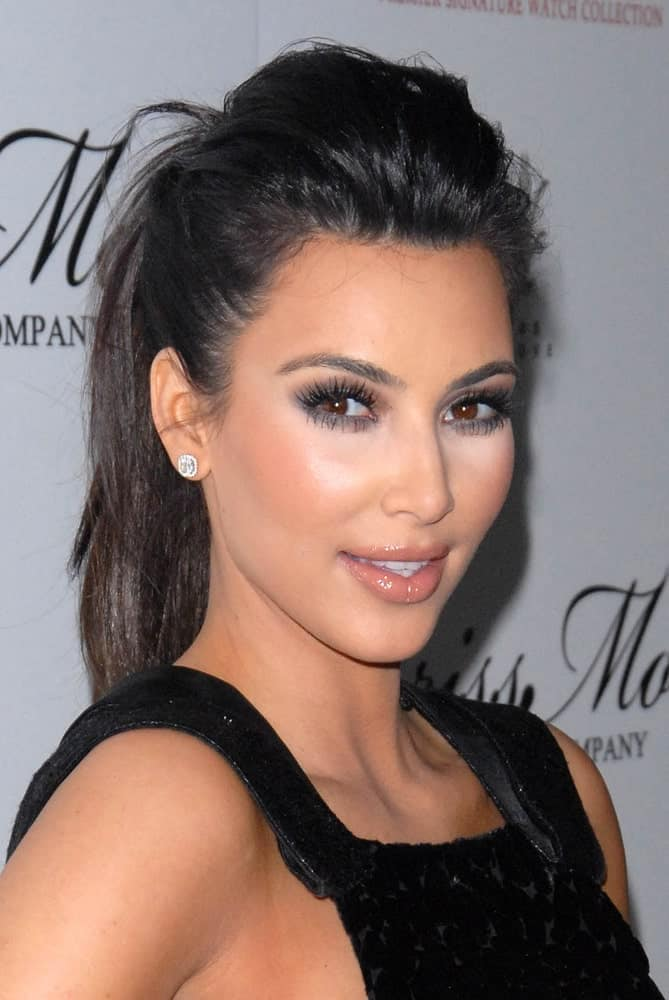 Kim Kardashian rocking a tousled pompadour ponytail at the launch of the Kim Kardashian Brissmor Signature Watch Collection on December 7, 2010, in Whisper Lounge, Los Angeles.