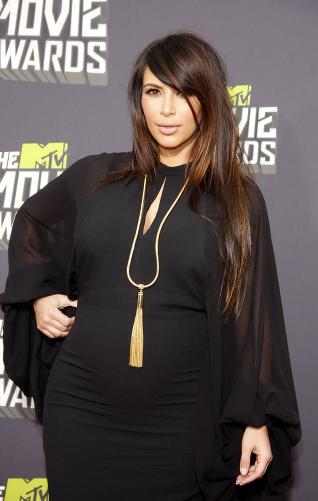 Kim Kardashian with her long tousled layered hair accentuated with brown highlights during the Movie Awards held at the Sony Pictures Studios in Culver City, CA on April 14, 2013.