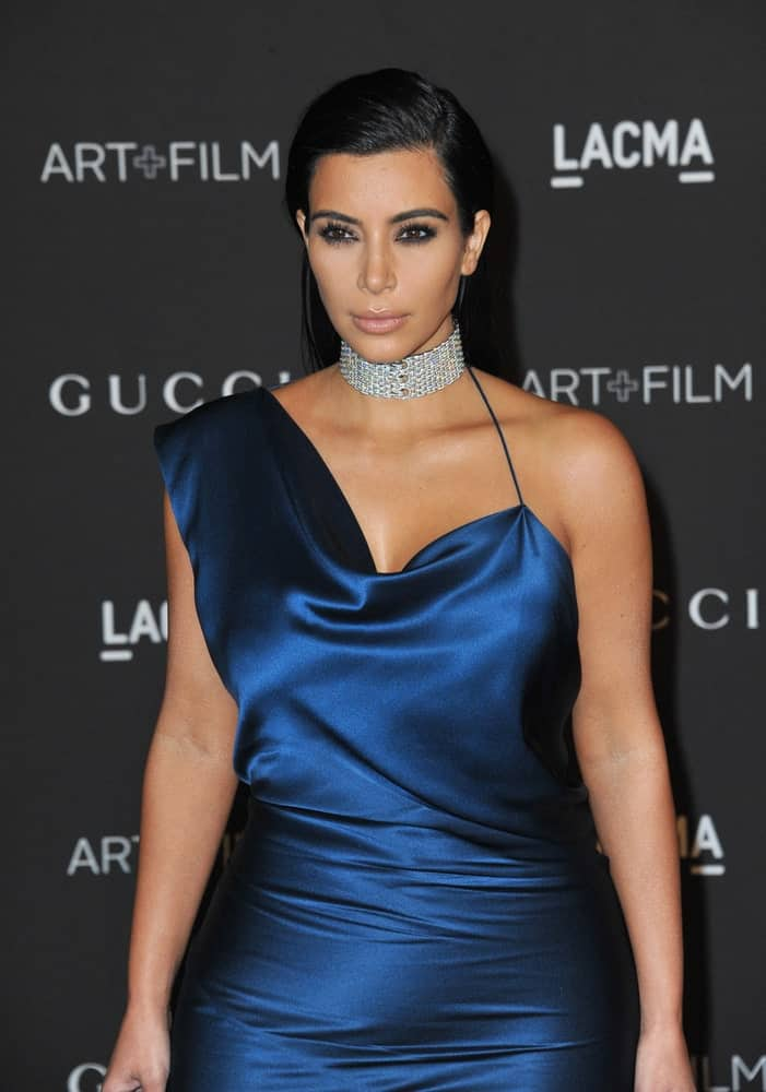 Kim Kardashian looked gorgeous in a blue satin gown paired with a choker necklace and her sleek side-parted hair at the 2014 LACMA Art+Film Gala at the Los Angeles County Museum of Art on November 1, 2014.