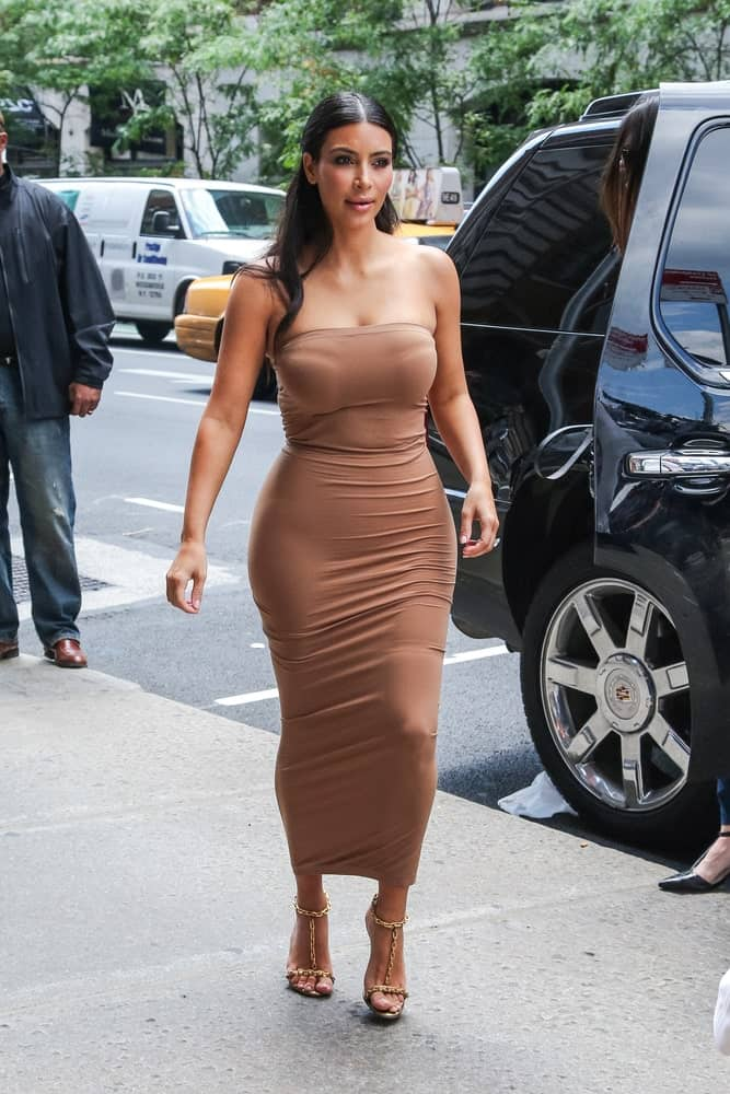 Kim Kardashian was spotted in New York City on June 27, 2014, wearing a long tube dress that complements her half-updo hairstyle.