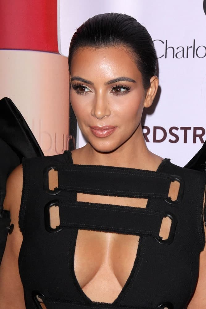 Kim Kardashian wore an edgy black outfit along with a very neat updo during the Charlotte Tilbury Makeup Your Destiny Beauty Festival at The Grove on October 9, 2014.
