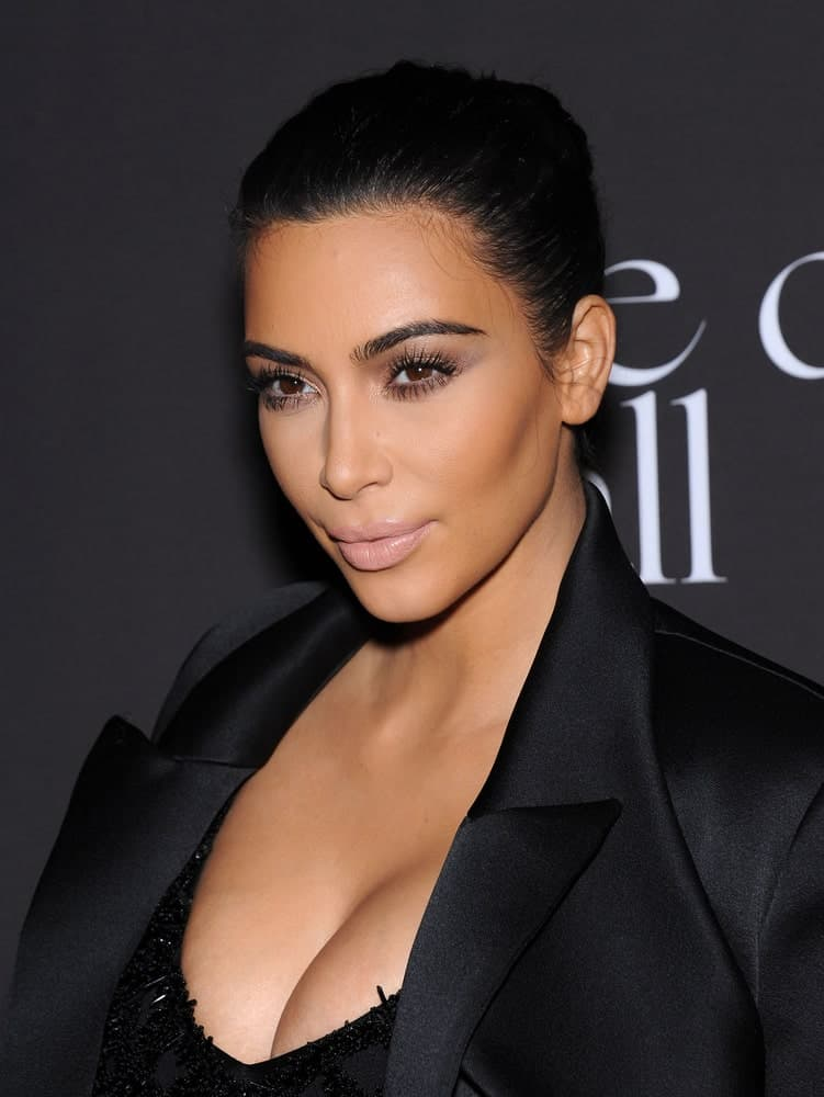 Kim Kardashian arranged her raven hair into a neat bun that perfectly matched her black outfit during The First Annual Diamond Ball on December 11, 2014, in Beverly Hills, CA.