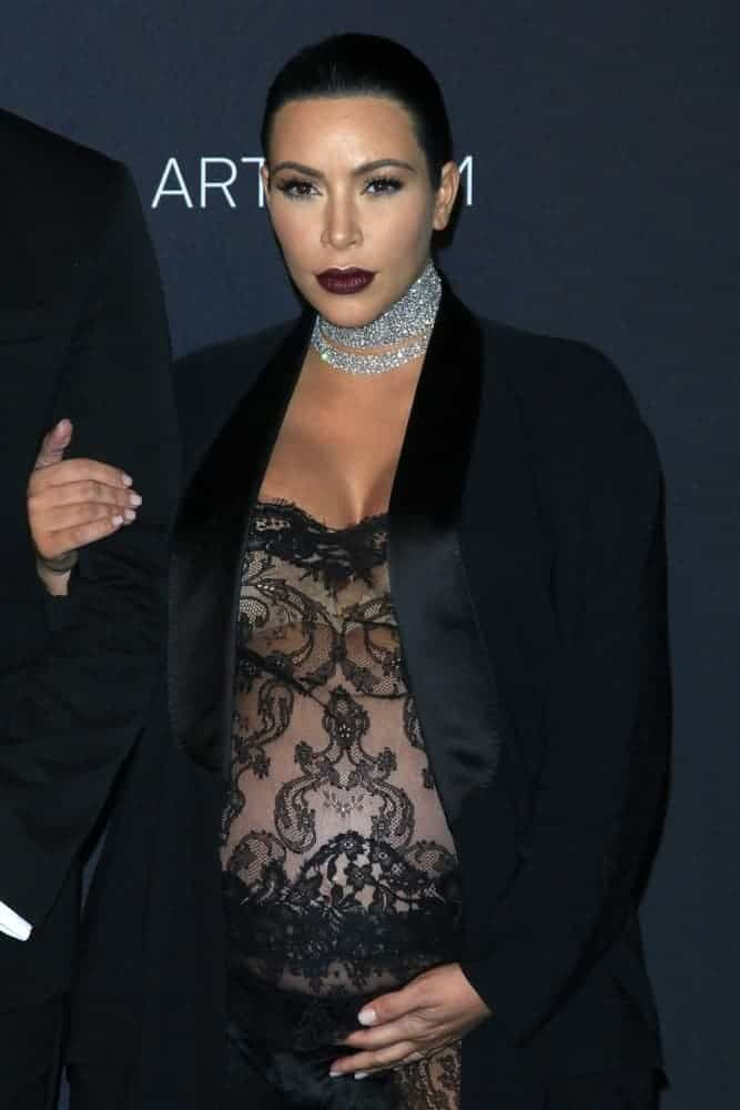 Pregnant Kim Kardashian pulled off a sexy and revealing see-through black lace jumpsuit and completed the look with a long, sleek fishtail braid hairstyle at the LACMA Art + Film Gala.