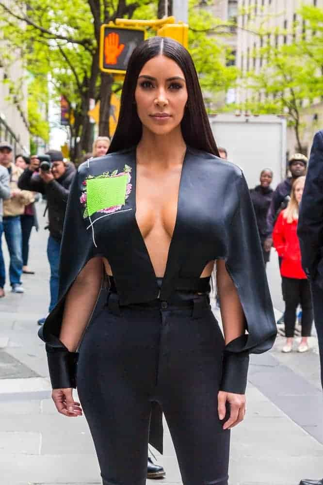 Kim Kardashian was seen in a glamorous long straight hairstyle with a center parting together with her very stylish cape-like top and black Balenciaga pants at the 2017 NBCUniversal Upfront event.