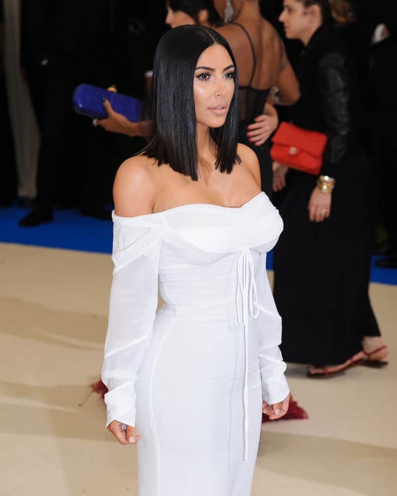 Kim Kardashian chose an elegant white off-shoulder gown and topped it off with super sleek shoulder-length center-parted hairstyle during the 2017 Metropolitan Museum of Art Costume Institute Benefit Gala.