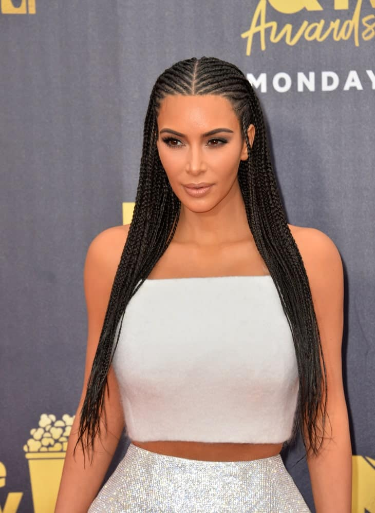 Kim Kardashian styled her long black locks with Fulani braid during the 2018 MTV Movie & TV Awards at the Barker Hanger, Santa Monica Airport last June 16th.