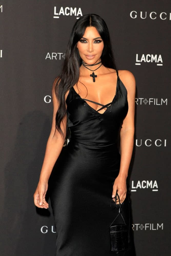 Kim Kardashian paired her black evening gown with dark loose waves at the 2018 LACMA: Art and Film Gala at the Los Angeles County Musem of Art on November 3, 2018.