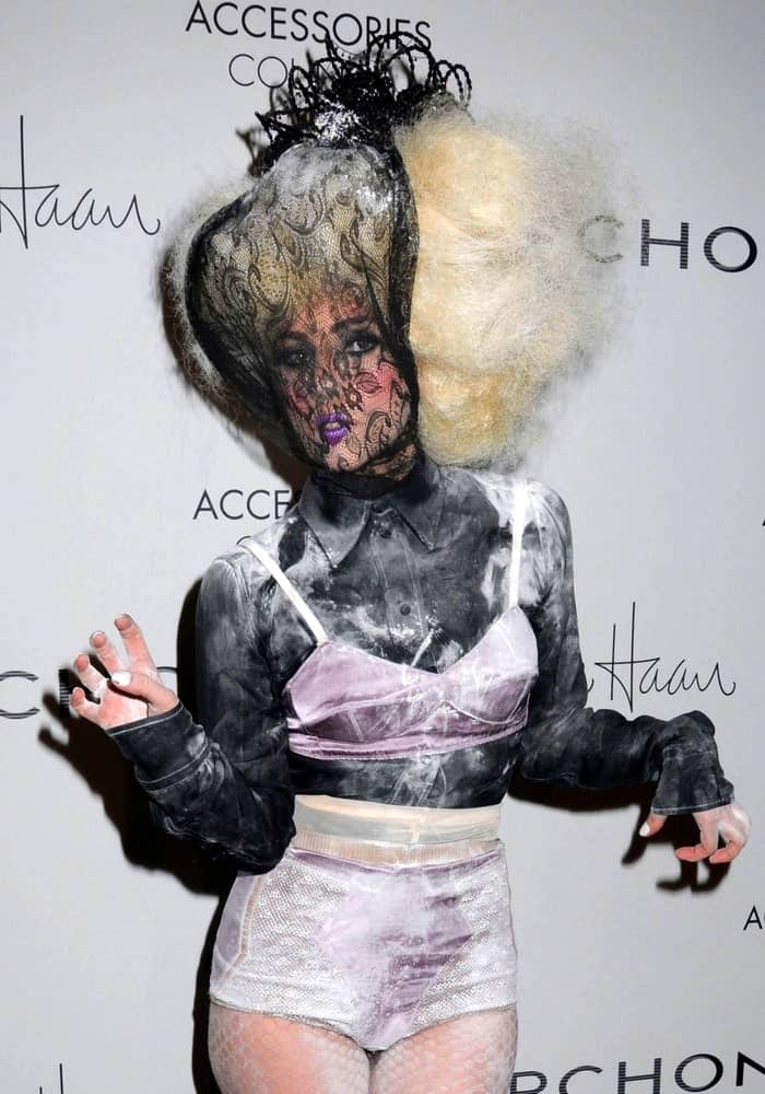 Lady Gaga wore Marc Jacobs bra and panties when she attended The Accessories Council 13th Annual ACE Awards in Cipriani Restaurant 42nd Street, New York on November 2, 2009. She had a black lace mask to go with her large blond afro hairstyle.
