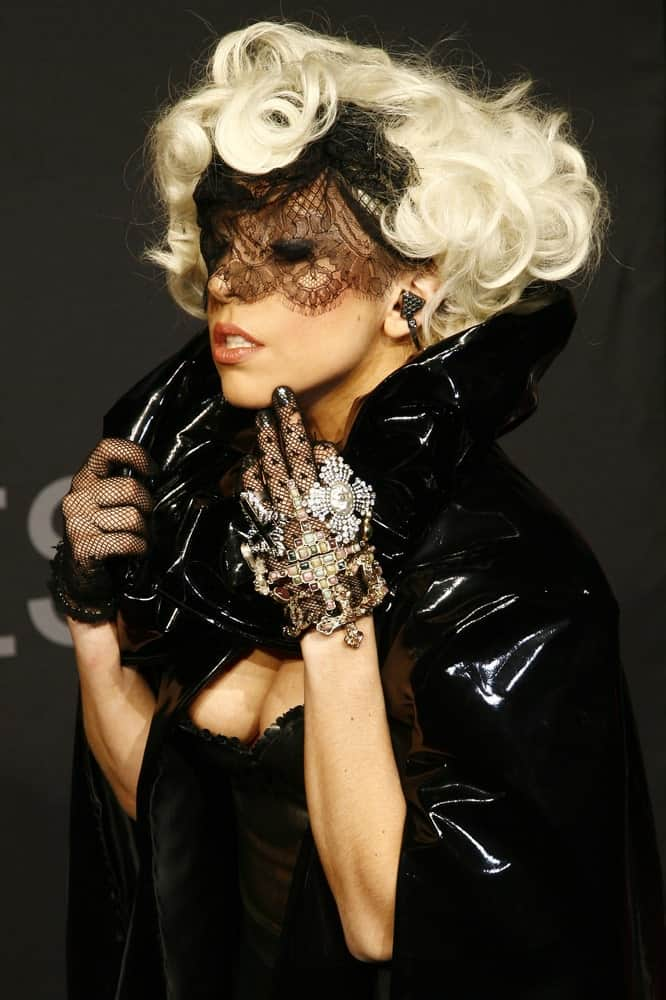 Lady Gaga attended the Monster Cable Party at the Tube Club on September 7, 2009 in Berlin, Germany. She wore a pure black outfit, black leather cloak and a black lace mask to contrast with her short and curly white blond hairstyle.