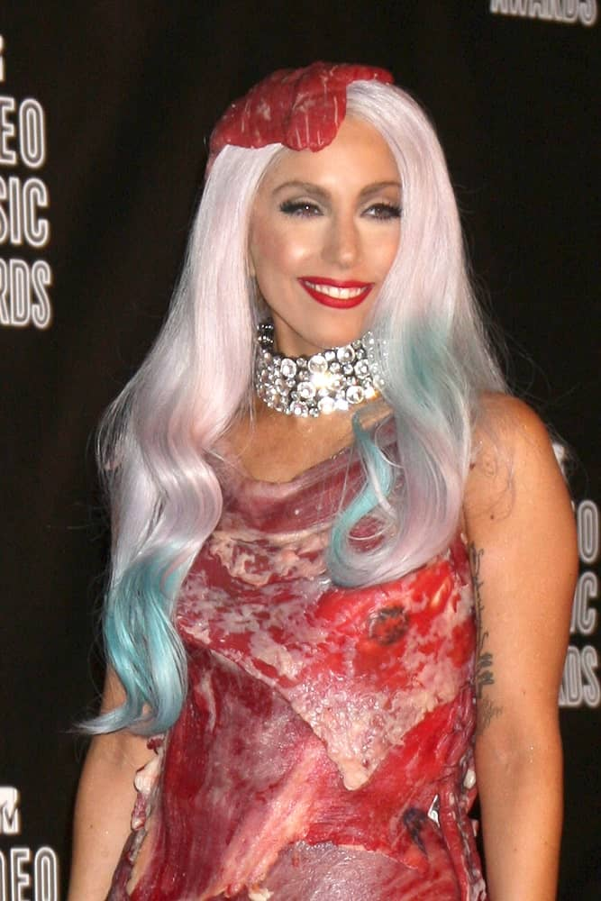 Lady Gaga was at the 2010 MTV Video Music Awards at Nokia - LA Live on September 12, 2010 in Los Angeles, CA. This was one of her controversial looks. She wore a dress and headdress made of raw red meat that she paired with a long wavy platinum blond hair with blue dyed tips.