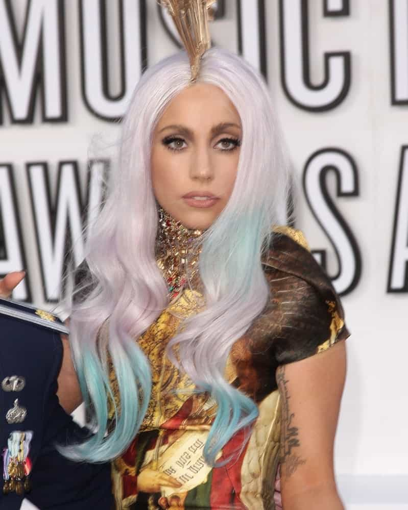 Lady GaGa attended the 2010 MTV Video Music Awards in Los Angeles, CA on September 12, 2010. She wore a colorful and artistic dress that complemented her pale platinum blond hairstyle with wavy blue dyed tips.