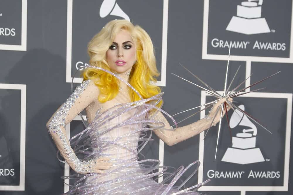 Lady Gaga was at the 52nd Grammy Awards at Staples Center in Los Angeles, California on January 31, 2010. She wore a star-themed artistic dress that complemented her loose and tousled blond hair with yellow dye at the tips.
