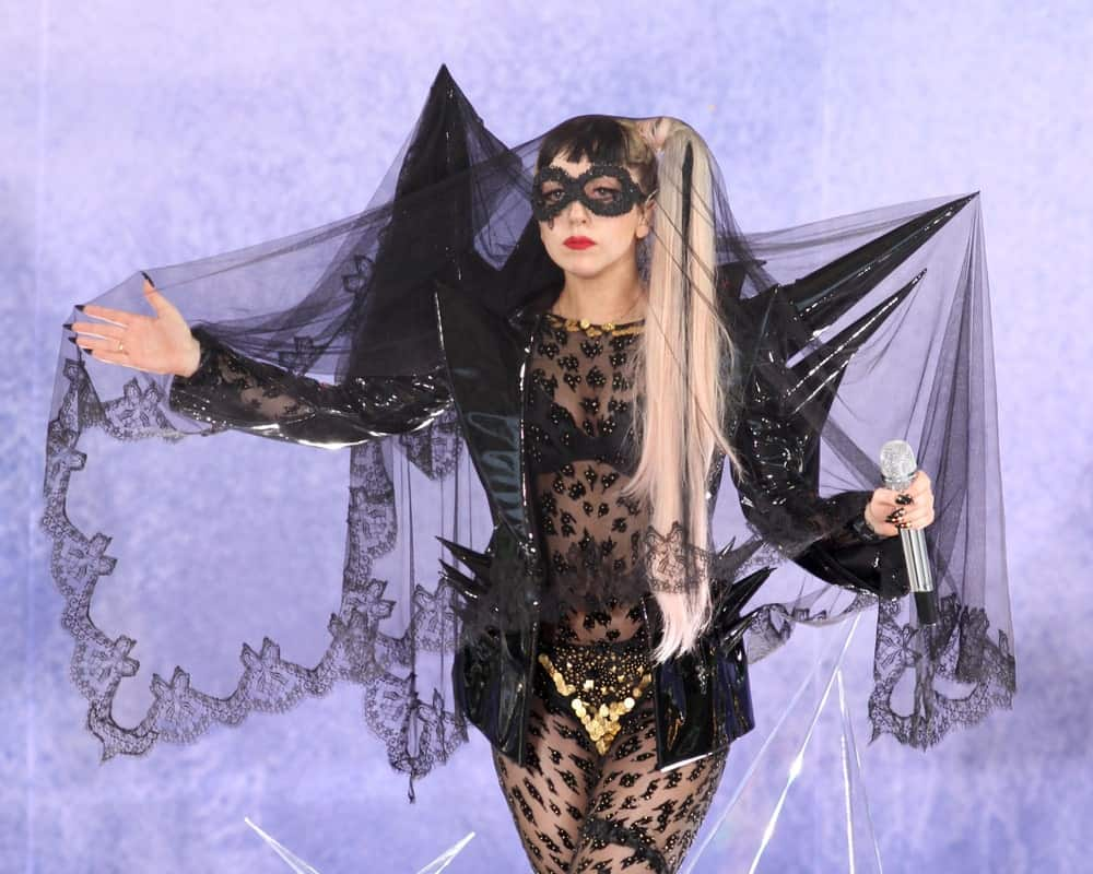 Lady Gaga performed on 'Good Morning America's' concert series in Central Park on May 27, 2011 in New York City. She was quite theatrical in her black lace outfit with a black spiked jacket and long dual-toned high ponytail with short blunt bangs.