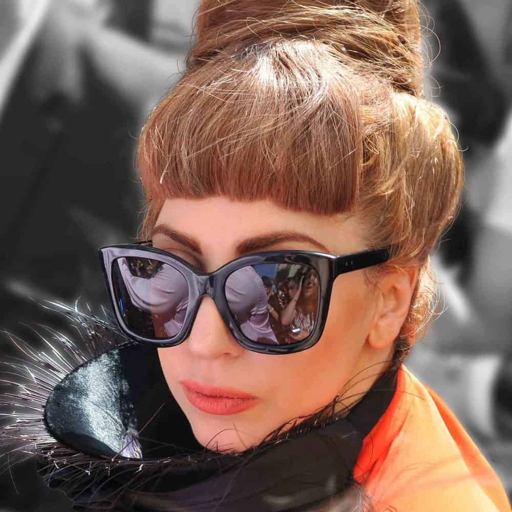 Lady Gaga was seen outside a London hotel in London on September 9, 2012. She was lovely with her cool sunglasses, gorgeous make-up and a tall beehive style top knot bun with a dark brown tone.