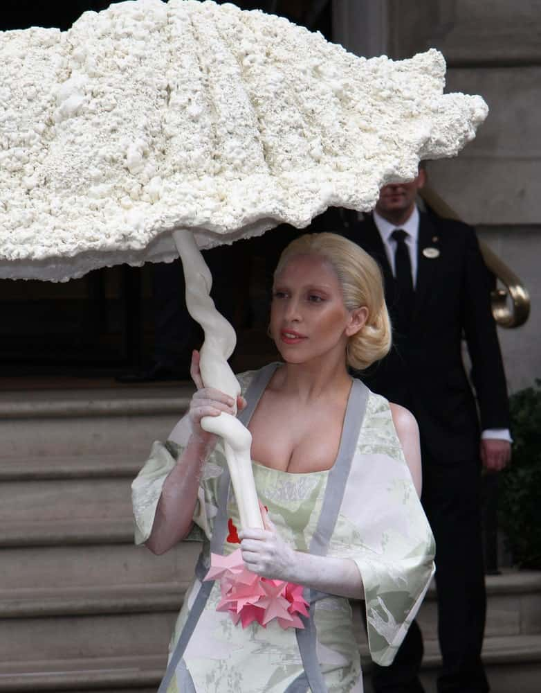 Lady Gaga was seen leaving her hotel on October 31, 2013 in London. She caught the attention of everyone with her unique umbrella, fashionable kimono-like outfit and brushed back blond hair with vintage curls at the tip.