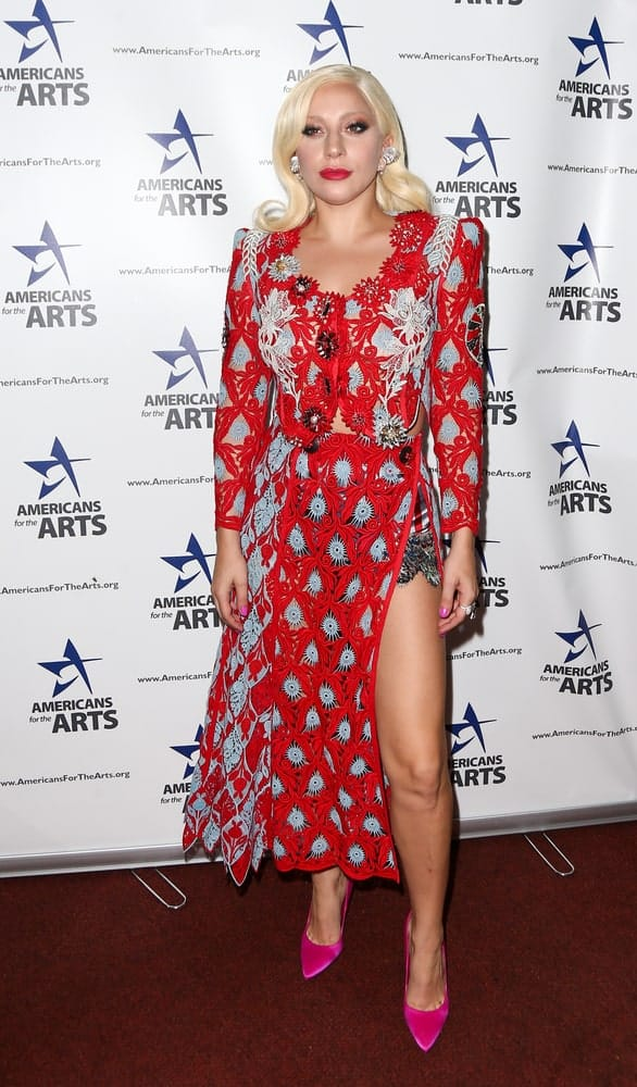 Lady Gaga went with a detailed red dress, red lips and a vintage look to her shoulder-length blond hair with a flippy tip by the shoulders when she attended the 2015 National Arts Awards at Cipriani 42nd Street on October 19, 2015 in New York City.