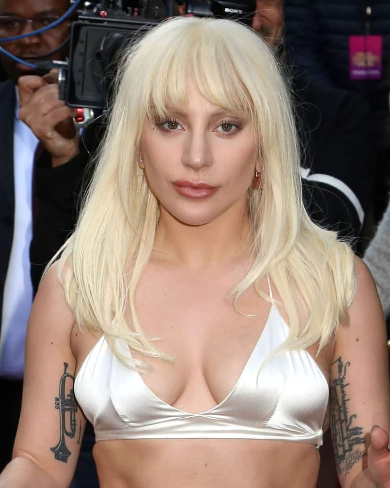 Lady Gaga attended the Billboard's 10th Annual Women in Music event at Cipriani on December 11, 2015 in New York City. She was simple and pretty in her two-piece white silk outfit that complements her loose and layered straight white blond hairstyle with bangs.