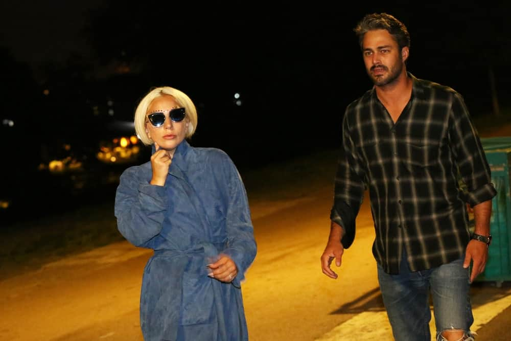 Lady Gaga and Taylor Kinney were seen walking the streets after dinner at a restaurant on July 4, 2015 in Belgrade, Serbia. Lady Gaga was wearing a blue velvet trench coat that she paired with cool sunglasses and a short tousled blond bob hairstyle.
