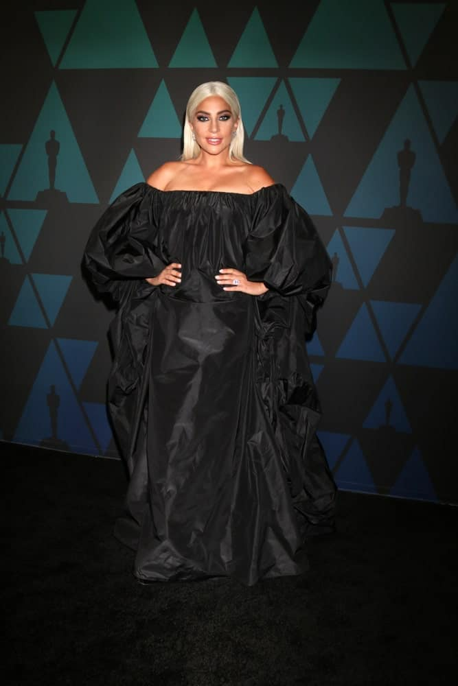 Lady Gaga was at the 10th Annual Governors Awards at the Ray Dolby Ballroom on November 18, 2018 in Los Angeles, CA. She paired her slick and smooth straight white blond hair with a pure black large gown.