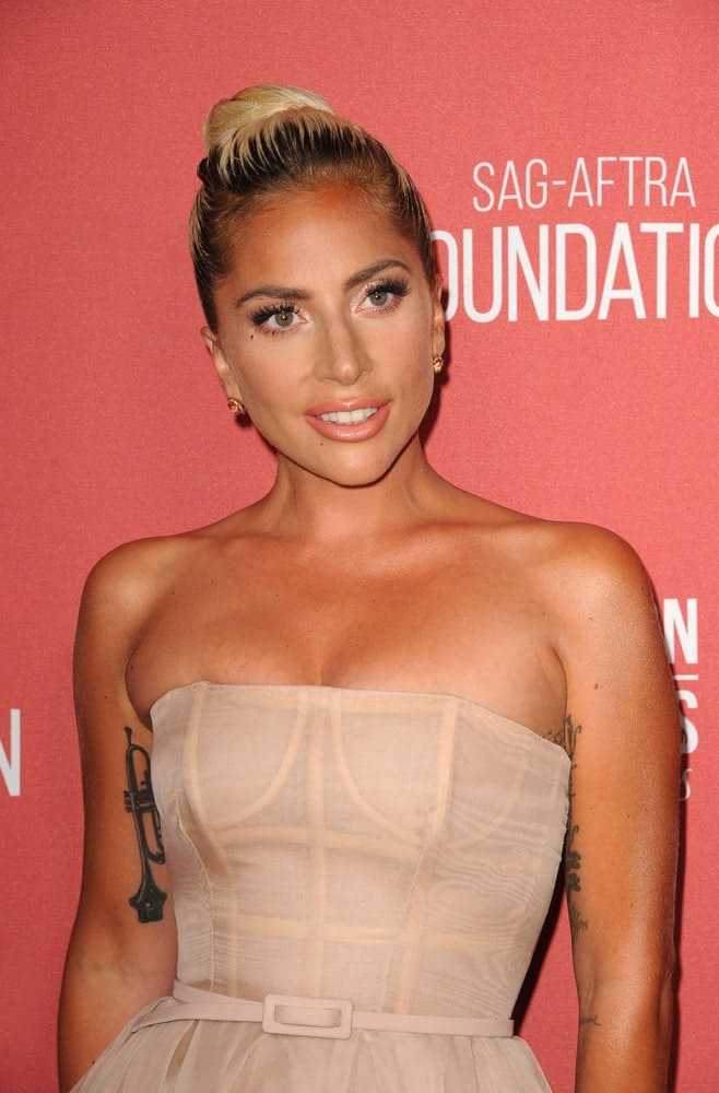 Lady Gaga attended the SAG-AFTRA Foundation's 3rd Annual Patron Of The Artists Awards held at the Wallis Annenberg Center in Beverly Hills on November 8, 2018. She looked lovely in her blush-colored cocktail dress that she paired with a highlighted high bun hairstyle.