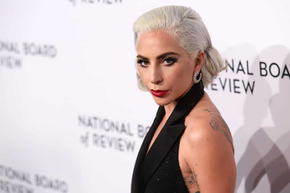 Lady Gaga's white blond hair was styled into a classy side-parted low bun when she attended the National Board of Review Awards at Cipriani on January 8, 2019 in New York.