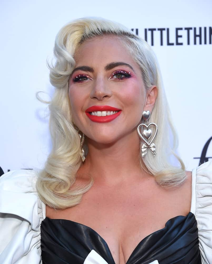 Lady Gaga looked quite classy in her black and white leather dress that she paired with a white blond hairstyle that has side-swept waves when she arrived for the The Daily Front Row 5th Annual Fashion LA Awards on March 17, 2019 in Beverly Hills, CA.