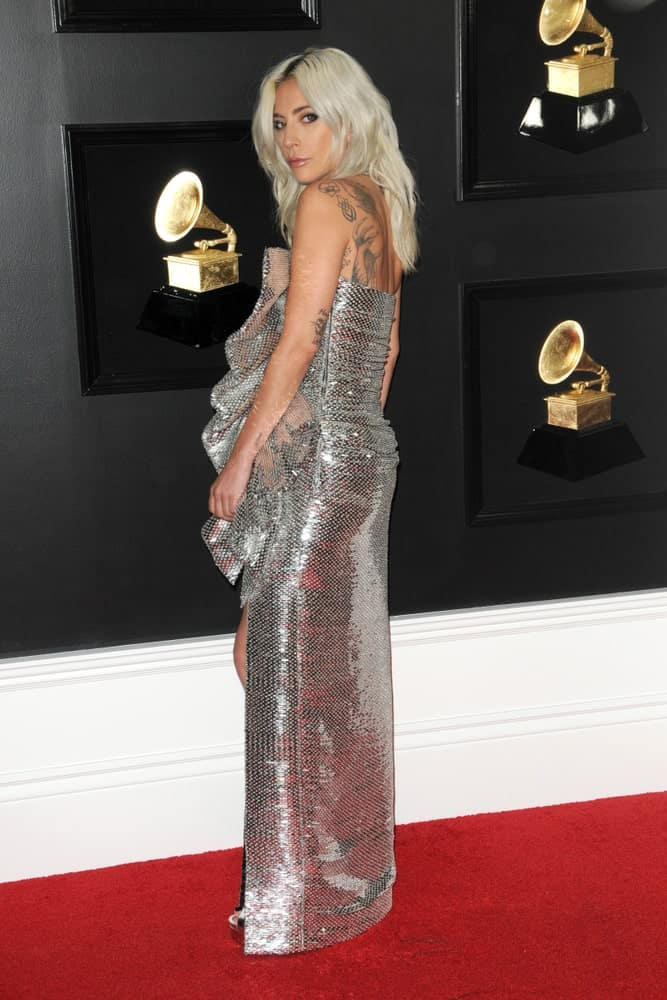 Lady Gaga wore a gorgeous long silver shiny dress that completely complements her loose long white blonde hair with layers and a slight tousle at the 61st Grammy Awards at the Staples Center on February 10, 2019 in Los Angeles, CA.