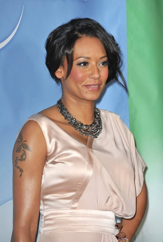 Mel B looks stunning in a silky nude dress that she paired with a glam updo at the NBC Universal's Winter 2010 Press Tour cocktail party on January 10, 2010.