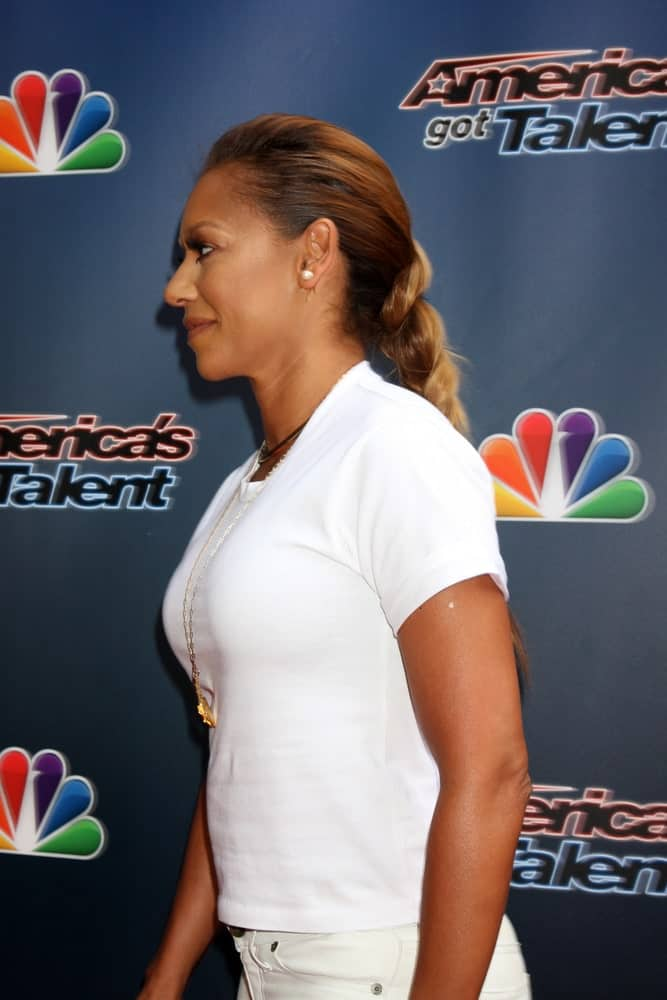 Mel B kept it casual in a white shirt and long braided ponytail during the