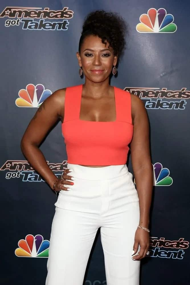 Mel B looking hot in her red cropped top and white trouser pants as she pulled her kinky hair up into a high-top ponytail hairstyle during the 'America's Got Talent' Season 10 Results Show on August 26, 2015.