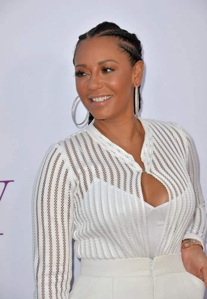 """Mel B is flawless in an all-white outfit and topping off her modesty, she wore a cornrow ponytail hairstyle at the world premiere of """"Mother's Day"""" on April 13, 2016."""
