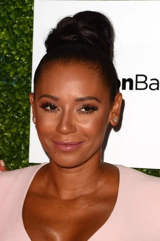 Mel B is pretty in a light pink dress with tresses piled in a big bun on top of her head as she attends the 2016 Ladylike Women of Excellence Awards Gala on June 4, 2016.
