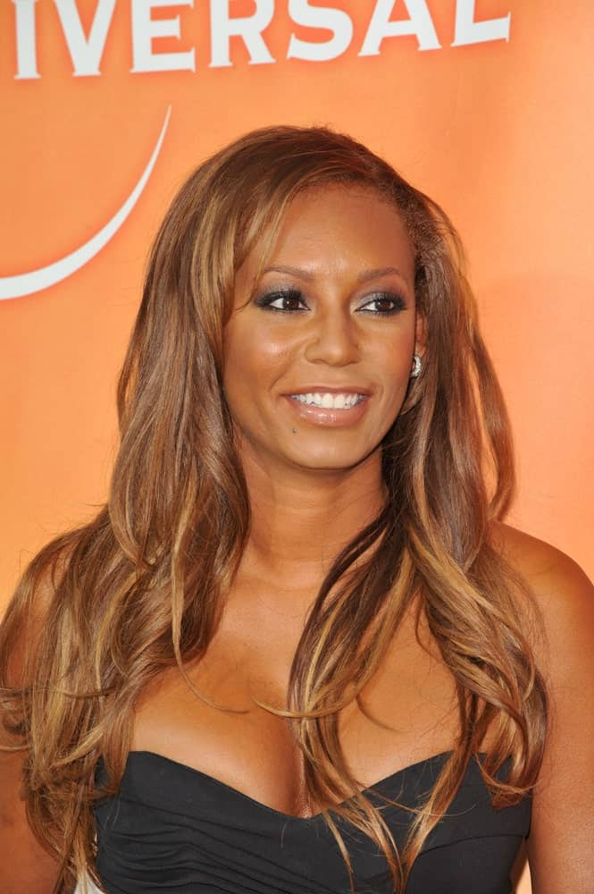 Mel B sports her brown highlighted tresses with subtle waves during the NBC Universal TV Summer Press Tour Party on July 30, 2010.