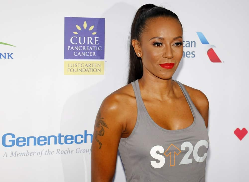 Mel B in a gray tank top and a high ponytail hairstyle at the 5th Biennial Stand Up To Cancer held on September 9, 2016.