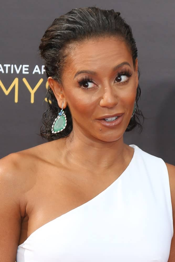 Mel B looking sleek in a brushed back half upstyle that she wore during the 2016 Creative Arts Emmy Awards - Day 1 - Arrivals on September 10, 2016. She topped it off with a white halter dress and oversized earrings.