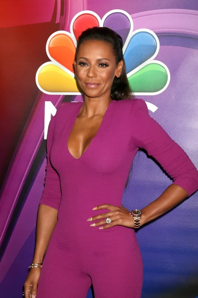 Mel B with her long dark locks arranged into a half upstyle as she attends the NBC Universal TCA Summer 2016 Press Tour on August 2, 2016.