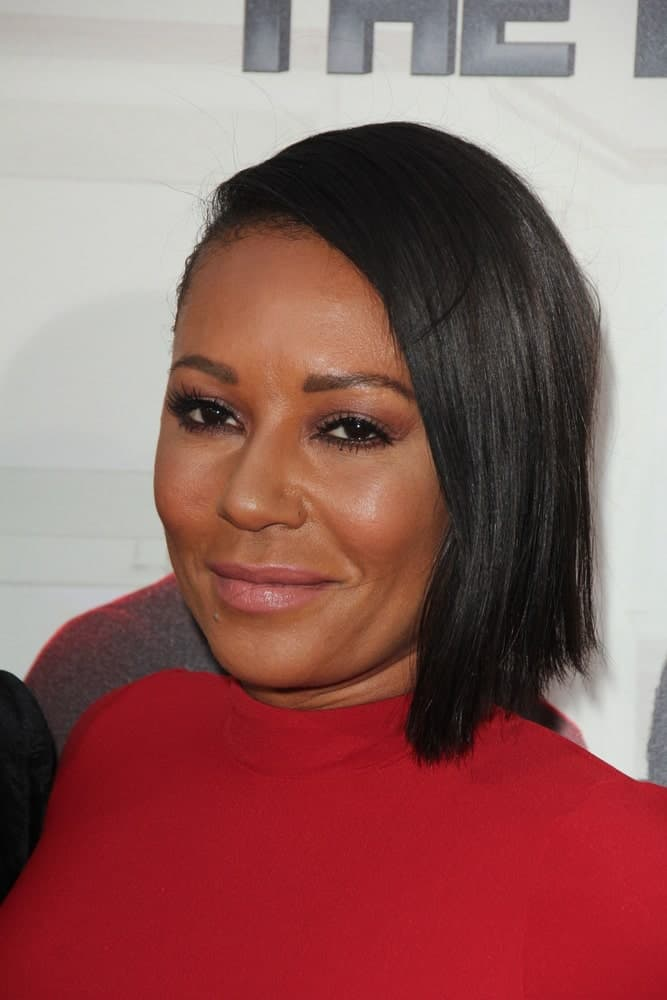 Mel B was spotted at the Barbershop - The Next Cut Premiere on April 6, 2016, wearing a red dress and black bob with a deep side parting.